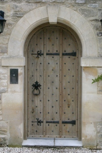 Oak boarded door with wrought ironwork