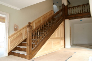 Oak staircase and painted softwood paneling